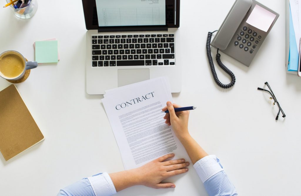 businesswoman signing contract document at office
